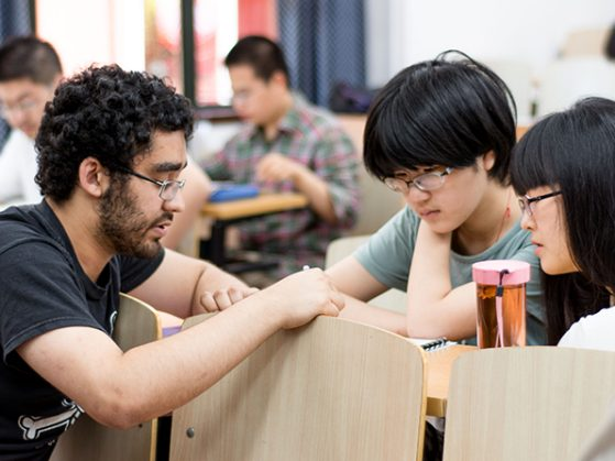 UM chemistry student conferring with Chinese chemistry student