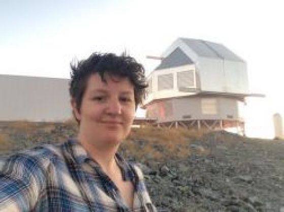 Traci Johnson in front of an observatory in Chile
