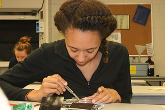 Imani Russell doing lab work