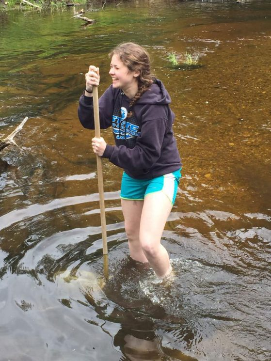 Maryellen Zbrozek collecting river samples during a General Ecology lab at the U-M Biological Station.