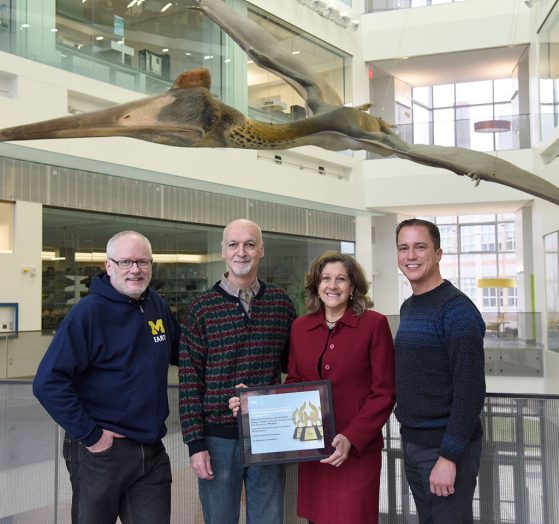 Left to right: Dale Austin, John Megahan, Gail Kuhnlein, Sean Green with web award certificate