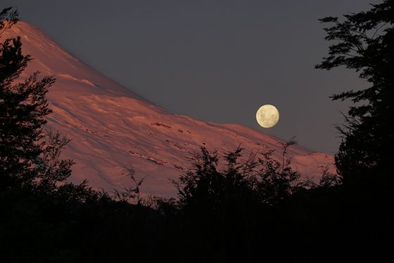"Third place: Rumaan Malhotra's ""Alpenglow on Volcan Osorno, as the moon rises,"" southern Chile."