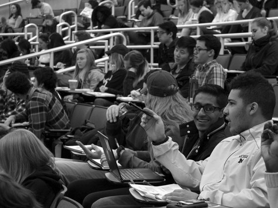 Students sitting in an auditorium in one of Meghan Duffy's introductory biology classes, black and white.