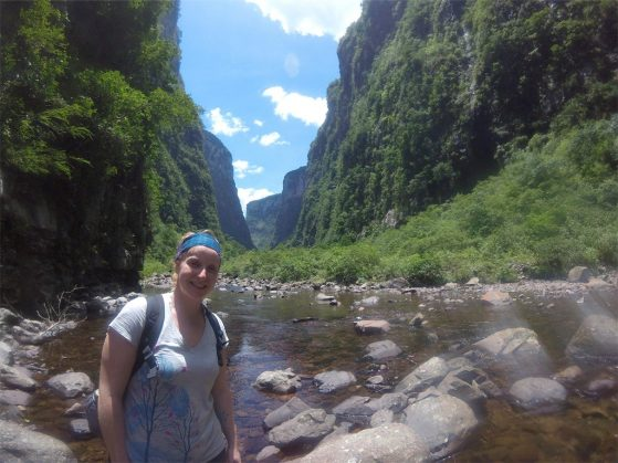 Andréa Thomaz hiking a trail in southern Brazil.