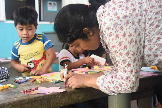 EEB graduate student Chatura Vaidya colors with the children.