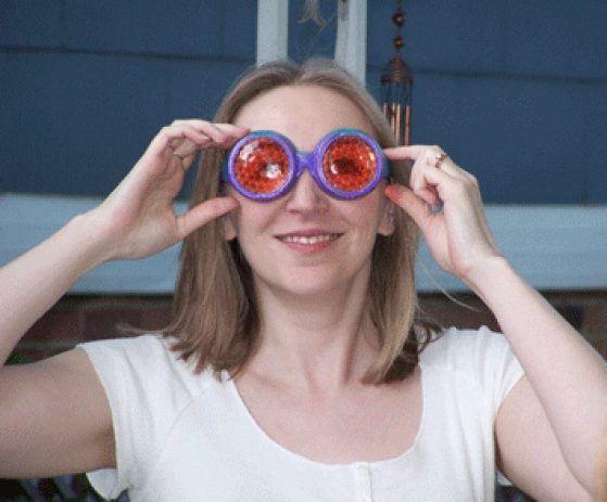 Patricia Wittkopp wearing red and purple fly vision goggles.