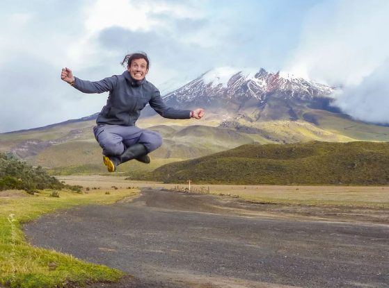 Simon Uribe-Convers is jumping for joy about these awards. Image taken in front of Cotopaxi, Ecuador.