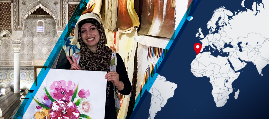 A divided image. On the left, Fatima Haidar holds a painting of pink flowers with her left hand and makes a peace sign with her right hand. On the right half is a map with a red dot in Morocco, indicating where Haidar worked as an intern.