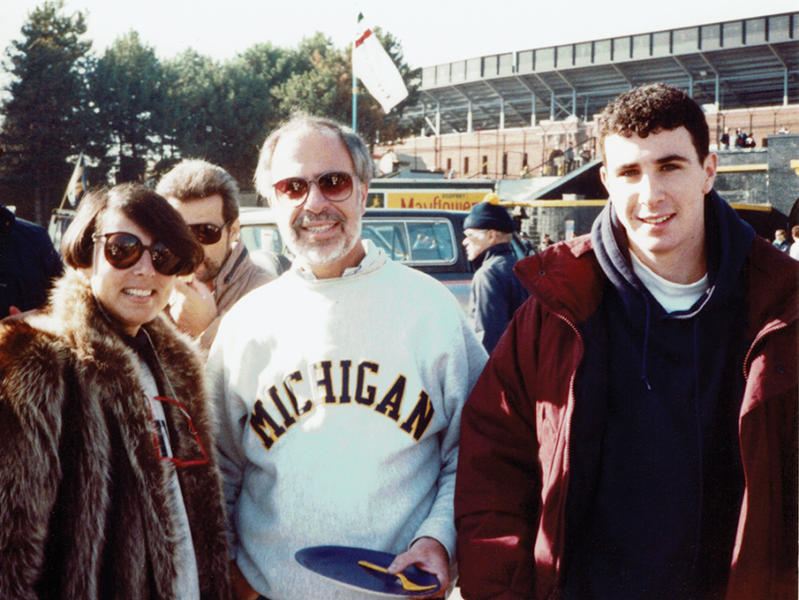 Jonathan Chait with his parents at a Michigan football game