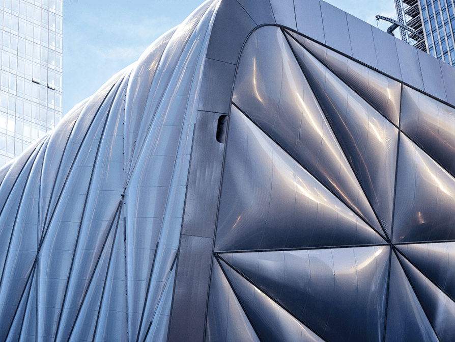 "The outer shell of the Shed, in New York's Hudson Yards neighborhood, weighs eight million pounds and moves on six-foot-tall bogie wheels, expanding or contracting based on the needs of the art space. LSA alumnus Justin Wong began working at the Shed the year before it opened, when it was ""just a skeleton with no escalator."""
