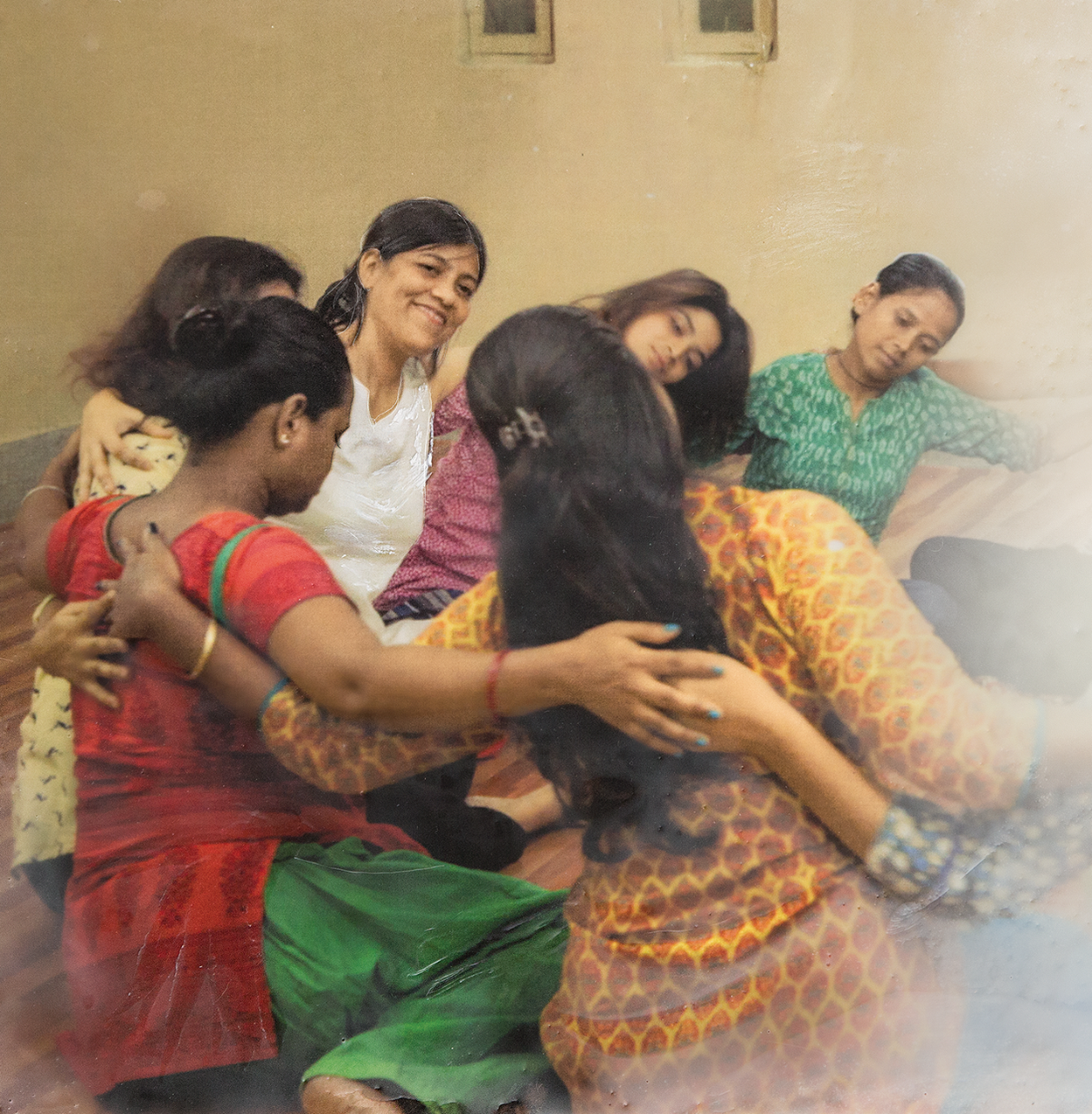 Sohini Chakraborty helping a group of survivors using dance/movement therapy.