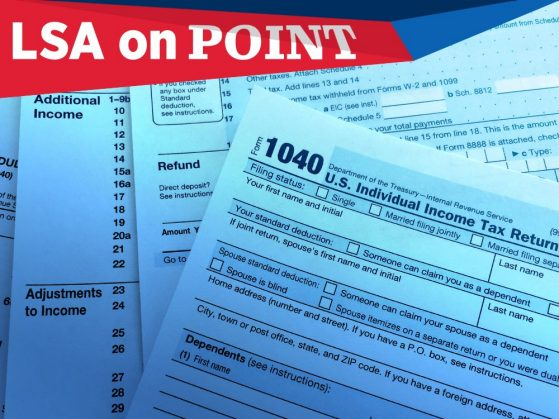 A photograph of a messy stack of tax forms. Form 1040 is on top.