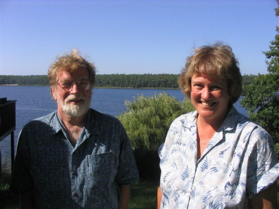 Brian Hazlett and Cathy Bach are pictured at the U-M Biological Station in this recent photo. It's a sunny day. You can see Douglas Lake in the background.