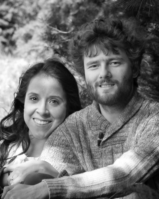 Miriam Llamas and Cody Ladd smile in a black and white photo