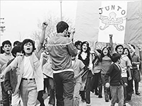 Cover image of La Raza catalog - group of people protesting