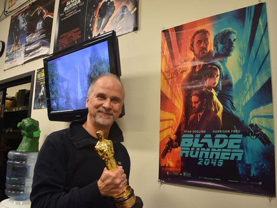 John Nelson poses with the poster for his 2018 Oscar Winner for Visual Effects, Blade Runner 2049.