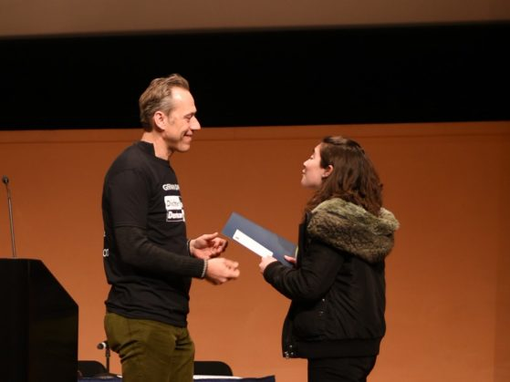 Johannes von Moltke, Germanic department chair, congratulates Astrid Tackett as she accepts the 2018 award on behalf of Robert Lederer