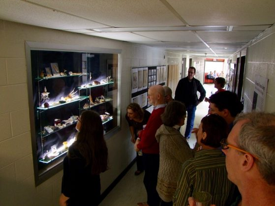 Attendees examine glass models during the Blaschka Exhibit Opening on March 24, 2017