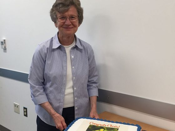 Christiane Anderson cutting her retirement cake