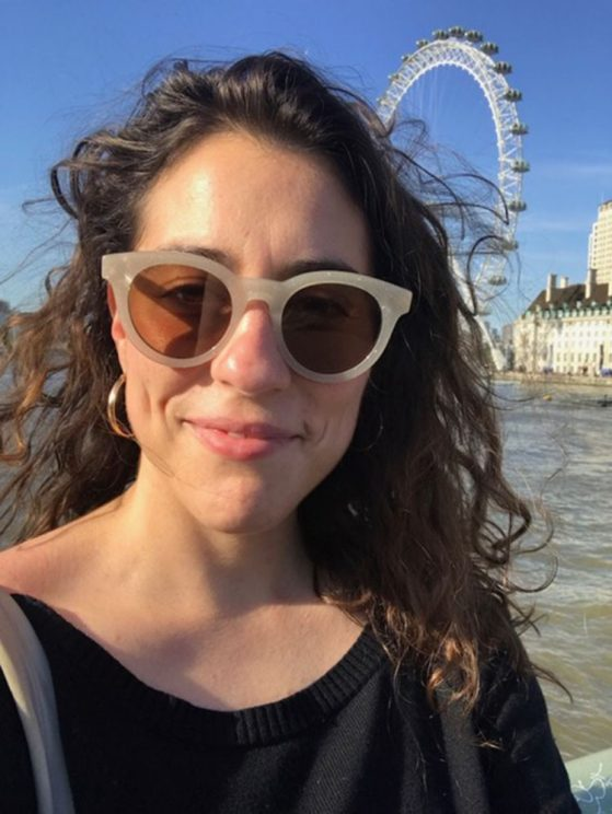 Image of Laura with sunglasses on with the London Eye behind her