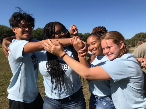 Four students at a team building event