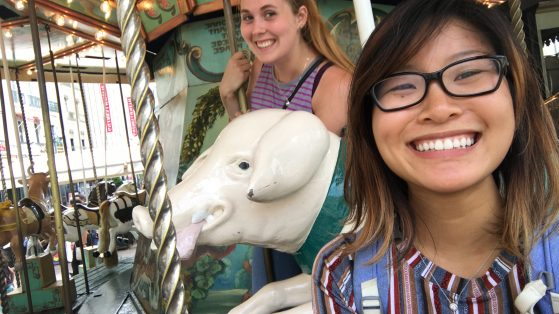Photo of Hannah Ma and Brenna Potter on carousel.
