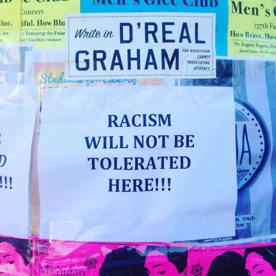 "Flyer reads ""Racism will NOT be tolerated here!!!"""