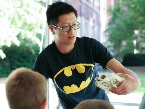 Jeff Shi tells children at the Ann Arbor Summer Festival: Top of the Park what we can learn about bats from their skulls.