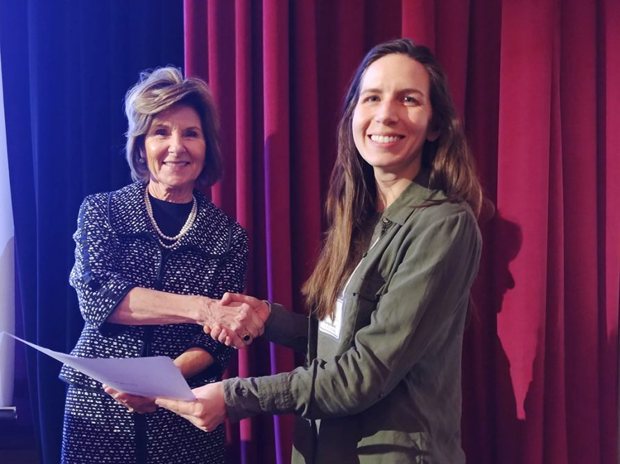 Giorgia Auteri receives the Midwest Bat Working Group's Best Student Oral Presentation award from Colleen Callahan, director of the Illinois Department of Natural Resources, in Chicago, Ill.