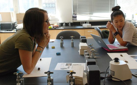 EEB graduate student instructor Lisa Walsh, who designed the new lab with Cindee Giffen, lecturer, discusses an experiment with students, including Jenna Lee.