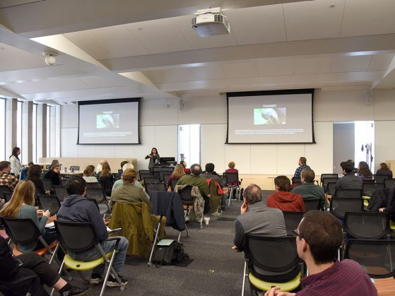 The 2019 Early Career Scientists Symposium was held in the Biological Sciences Building for the first time. View from the back of the room with speaker in the front and many people in the audience.