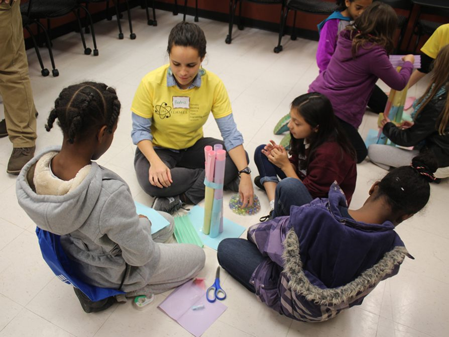 Beatriz Otero Jimenez helps guide the girls through an activity during the FEMMES Fall Capstone.