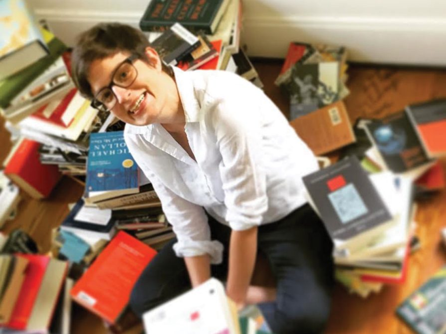 picture of Alice Goff surrounded by books