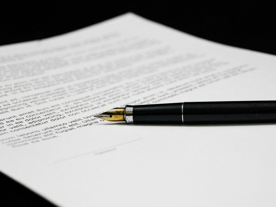 stock image of a fountain pen on a paper with typing