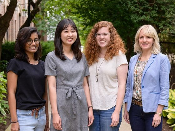 Group photo of 4 new graduate students