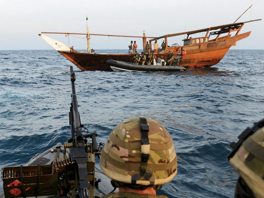 A photograph of international naval forces monitoring suspected pirate crafts