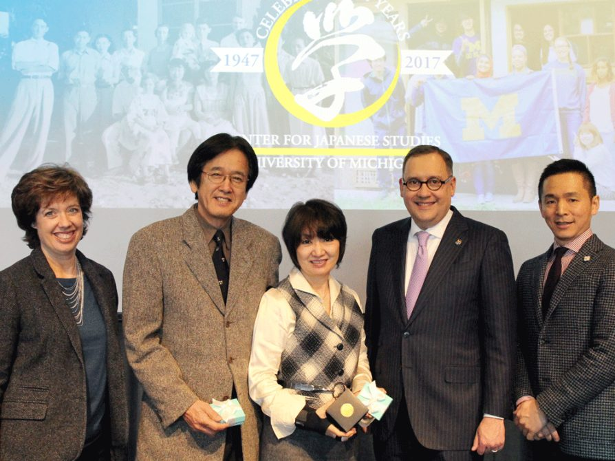 From left to right: Gail Flynn, Masao Oka, Mayumi Oka, and Andrew Martin stand onstage for a photograph