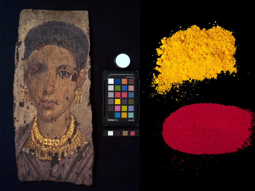 A black rectangle with a portrait of a woman on the left, a palette of colors in the middle beneath a white dot, and, on the right, two small piles of powder: an ochre powder on top and a red powder beneath it.