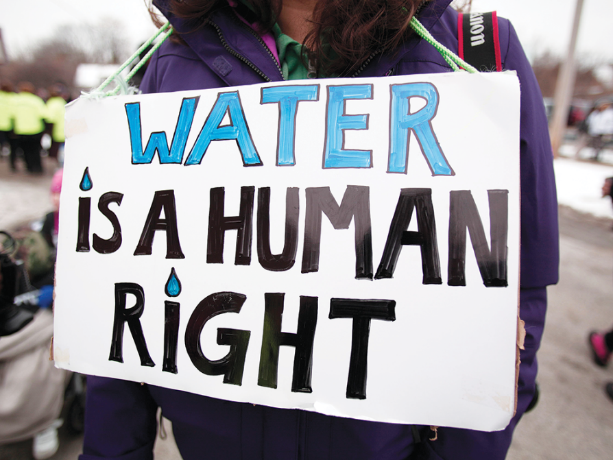 "A handmade sign that reads ""Water Is a Human Right"""
