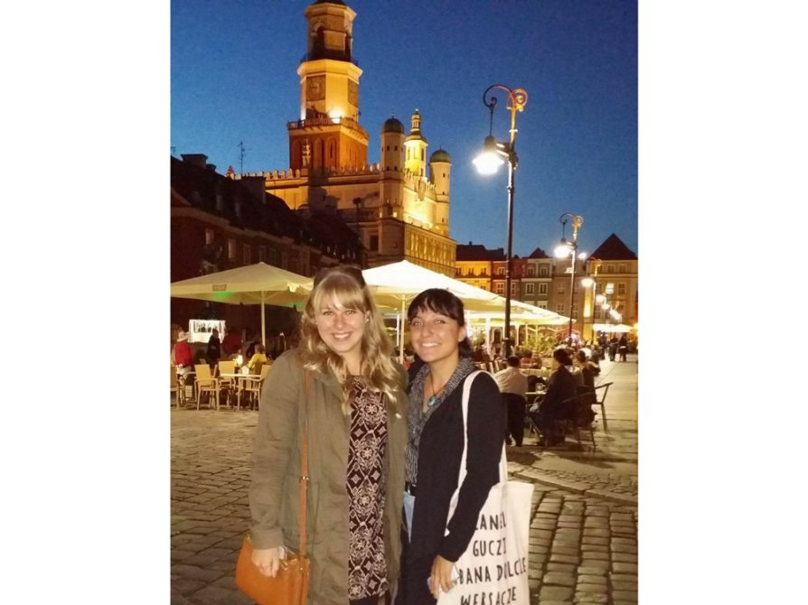 Gabrielle Wasilewski (on the left) with a friend from Turkey at an entrance to the Stary Rynek of Poznań (Ratusz building  in background)