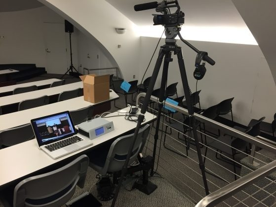 Classroom with video camera on tripod. Camera is connected to laptop.